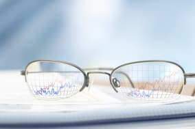 Eyeglasses and Line Graph Annuity stocks stock market research concept; blurred; selective focus; nobody; radius images; busines