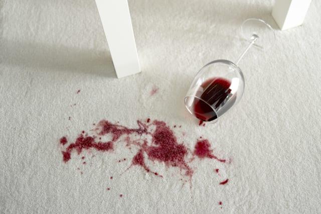 Spilled wine on white carpet