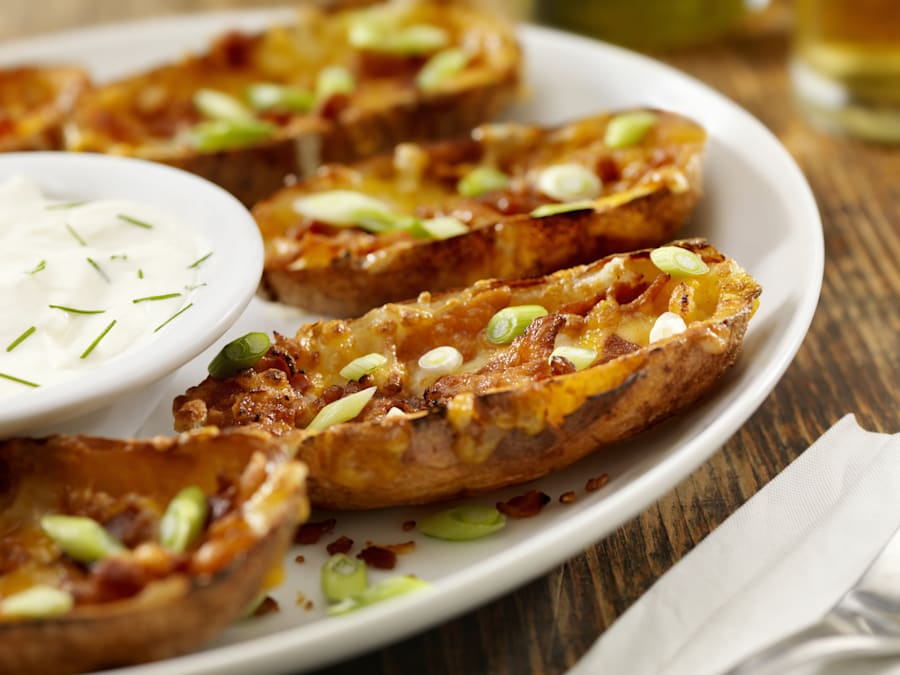 Bacon and cheddar stuffed potato skins with sour