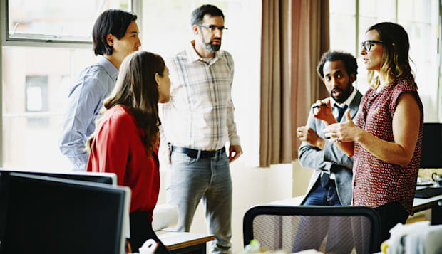 Businesswoman leading project discussion in office