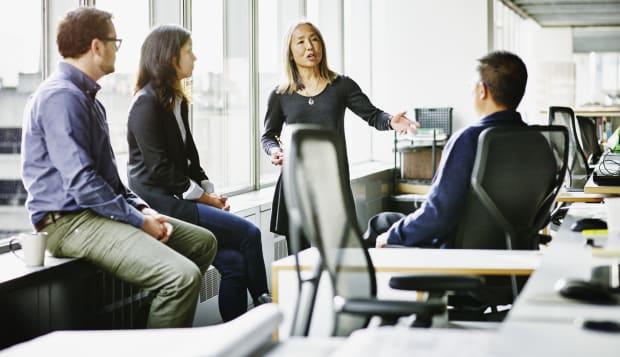 Mature businesswoman leading team meeting