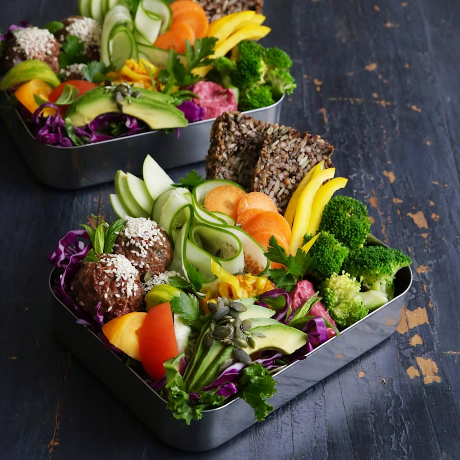 Fill a bowl or lunch box with salad, toast and meatballs for a light, fresh lunch or
