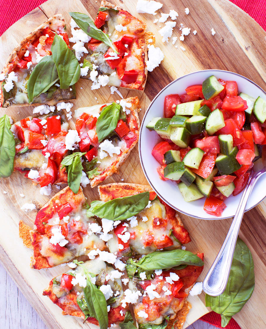 Heat these mini pizzas up in your work microwave or sandwich toaster, and serve alongside the fresh Greek...