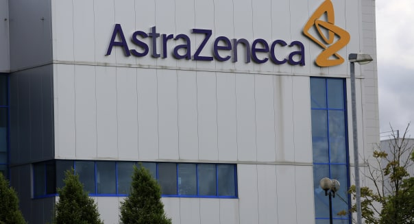 An AstraZeneca Plc sign sits outside the company's factory in Macclesfield, U.K., on Thursday, July 4, 2013. AstraZeneca recently announced it will cut about 1,600 jobs as it overhauls research and development, leading to $1.4 billion in costs as new Chief Executive Officer Pascal Soriot tries to revive the U.K.'s second-biggest drugmaker. Photographer: Paul Thomas/Bloomberg via Getty Images
