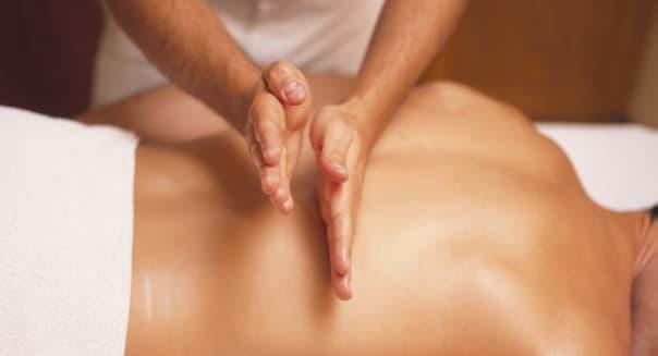Hands Massaging Man's Back