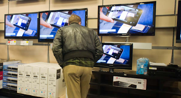 Shopping in the flat screen television department in a Best Buy electronics store in Midtown Manhattan in New York