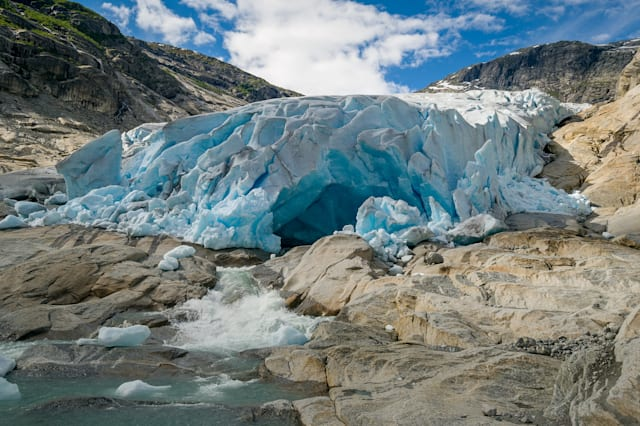Nigardsbreen Glacier ice cave and river