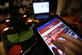 File photo dated 25/12/2013 of a woman viewing a sale being promoted on the Currys website on a tablet, in London. More Britons than ever did their Christmas shopping online in December as almost one in five non-food purchases were made on the internet. PRESS ASSOCIATION Photo. Issue date: Friday January 10, 2014. Web sales growth accelerated to 19.2% compared with the same month in 2012, the fastest rate for more than three years - while overall UK retail sales grew by just 0.4% on a like-for-like basis. See PA story ECONOMY Retail. Photo credit should read: Yui Mok/PA Wire