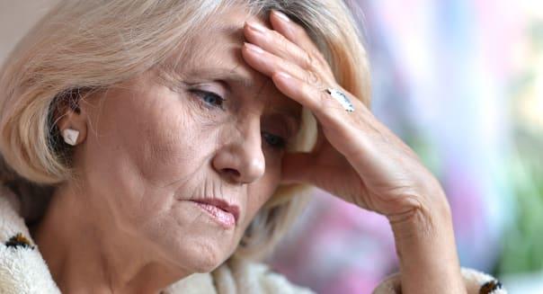 sad elderly woman sitting in a room