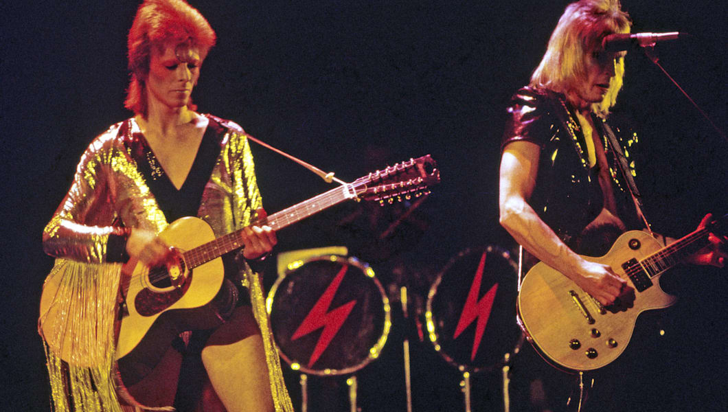 DAVID BOWIE as Ziggy Stardust with Mick Ronson at right in 1972