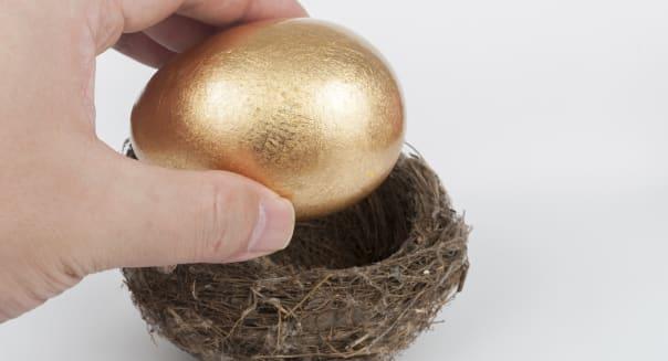 Putting golden egg in nest