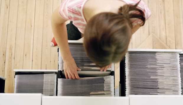 A woman searching in an archive.