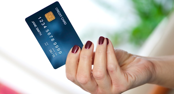 woman hand holding credit card...