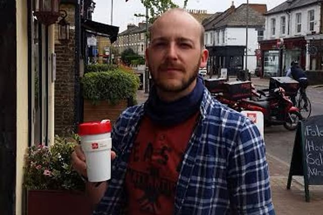 Peter Kohler with his own mug he has owned for two years. See Masons copy MNMUG: A Virgin Trains passenger was told he could not use his own mug to buy a coffee because it was not 'risk assessed'. Environmentalist Peter Kohler has carried his personal plastic mug for two years as his way of cutting back on waste from disposable mugs. But when he went to buy an Americano on Virgin's Edinburgh - London train a steward refused to fill his mug because it had not been approved by the company. Peter, 33, who runs a project called The Plastic Tide which carries out beach cleans around Britain, cancelled his order and went without the £1.95 drink.