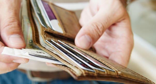 B0FR95 Man removes cash from wallet  cash; man; money; removing; wallet; accessory; adult; billfold; dollar; dollars; fellow; ge