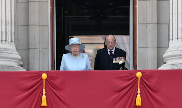 Queen Elizabeth ll and Prince Philip, Duke of Edinburgh look out from the balcony of Buckingham Palace...