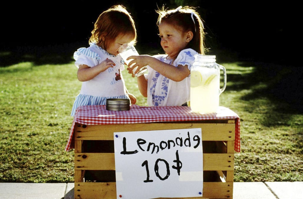 Two girls at running lemonade stand