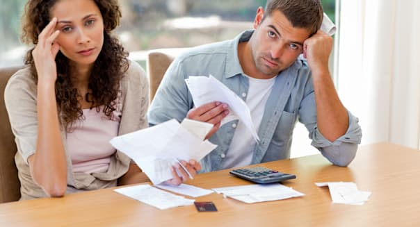 C25PWT Young couple calculating their domestic bills Man money paperwork Young; couple; calculating; domestic; bills; adult; att