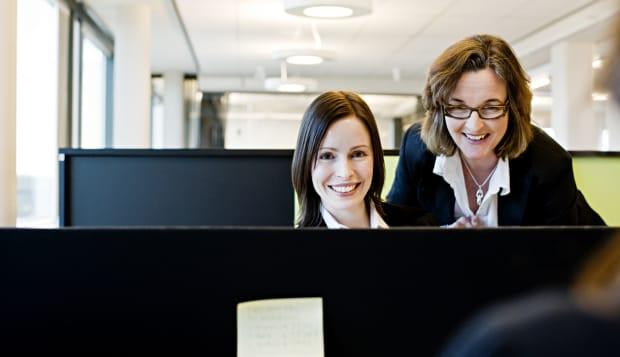 Two businesswomen at desk
