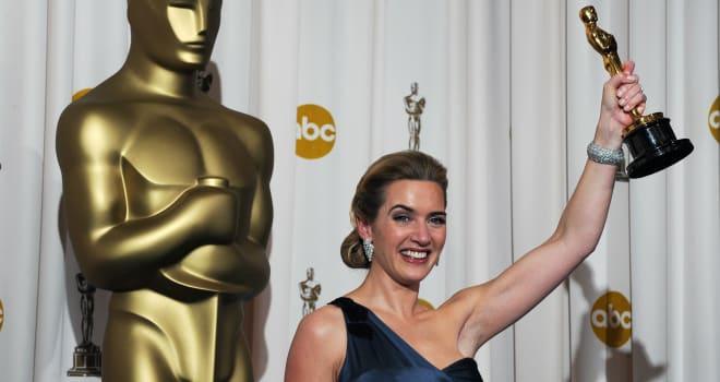 Best Actress winner Kate Winslet poses w