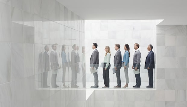 Business people in a row on balcony in modern office