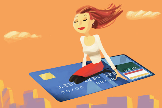 Woman flying on a credit card