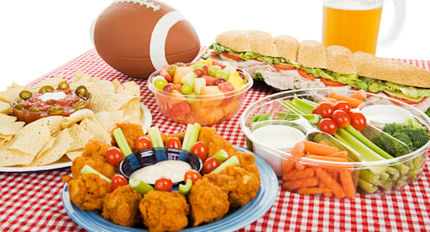 B9167H Table spread with appetizer trays for the footbal party Horizontal view over white background . football; superbowl; amer