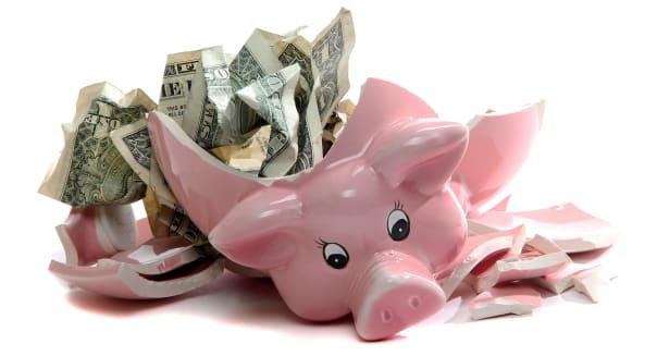 broken piggybank with dollar...