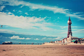 Blackpool Tower and pier taken from beach.