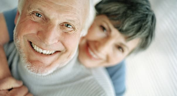 Mature Couple Hugging and Smiling