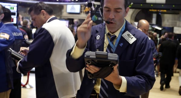 new york stock exchange trader investing federal reserve minutes oil prices