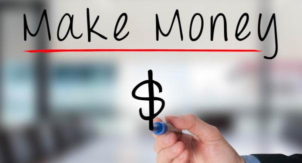 businessman hand write make money online on virtual screens.Dollar symbol.