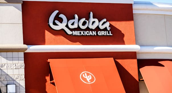 Qdoba Mexican grill sign and logo on the front of the restaurant in Oklahoma City, Oklahoma, USA.