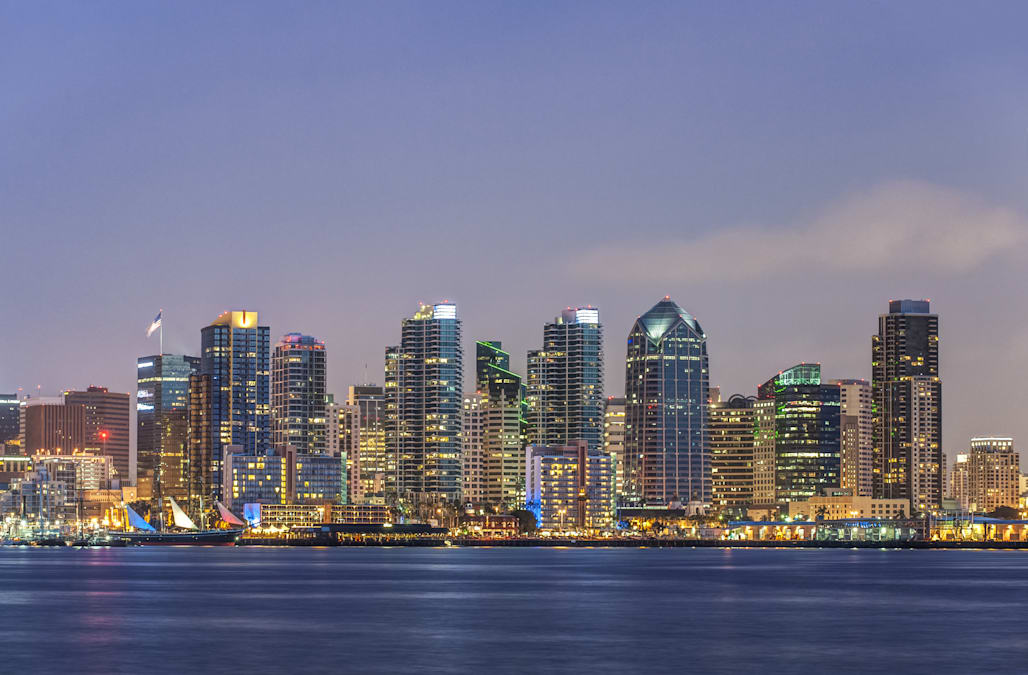 City skyline lit up at night, San Diego, California, United States