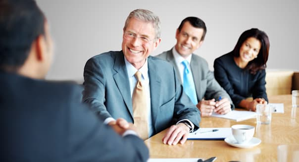 Successful business people shaking hands in a meeting at office