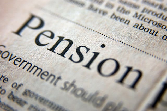 A2CWRN Royalty free photograph of pension business headline in UK financial times pension; retirement; old; age; pensioner; prop