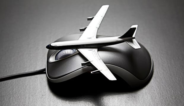 BPY8J6 Toy airplane placed on a computer mouse Computer; mouse; peripherals; fly; vacation; jet; order; purchase; buy; online; i