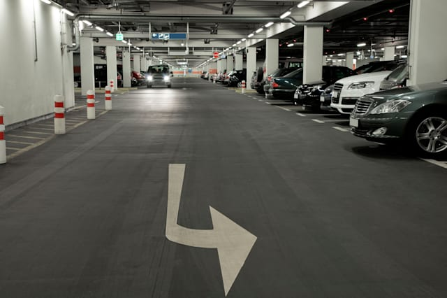 B155PA Underground parking garage. Image shot 2008. Exact date unknown. parking; garage; car; underground; arrow; architecture;