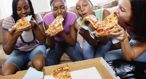 Five Teenagers Eating Pizza