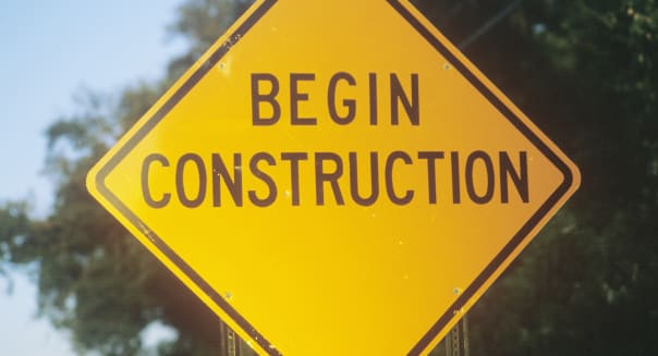 A sign that reads ?Begin Construction?