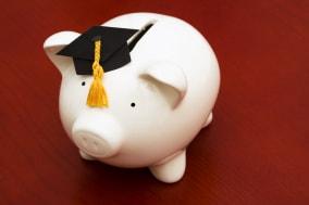 piggy bank with graduation cap  ...