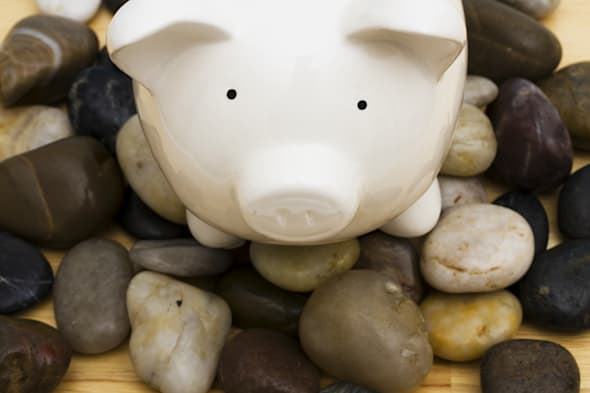 piggy bank on rocks     ...