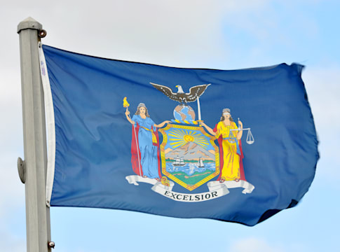 flag of new york state in blue...