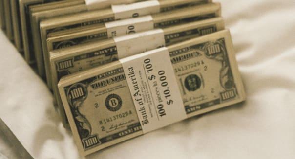 Still life of stacks of one hundred US dollars