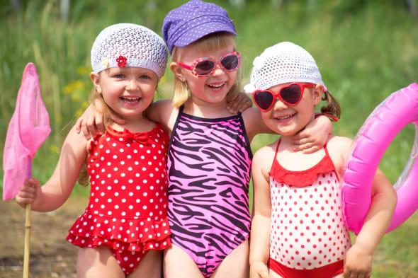Three little cute girls having good summertime