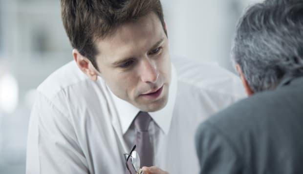 Businessmen discussing work