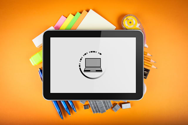 Tablet with office supplies background