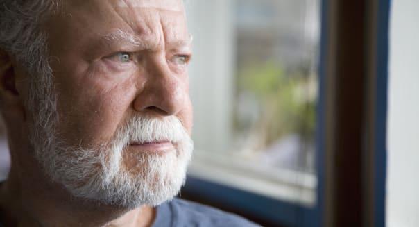 Senior man looking away, close-up