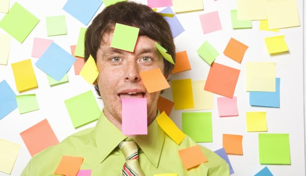 Businessman with adhesive note on forehead