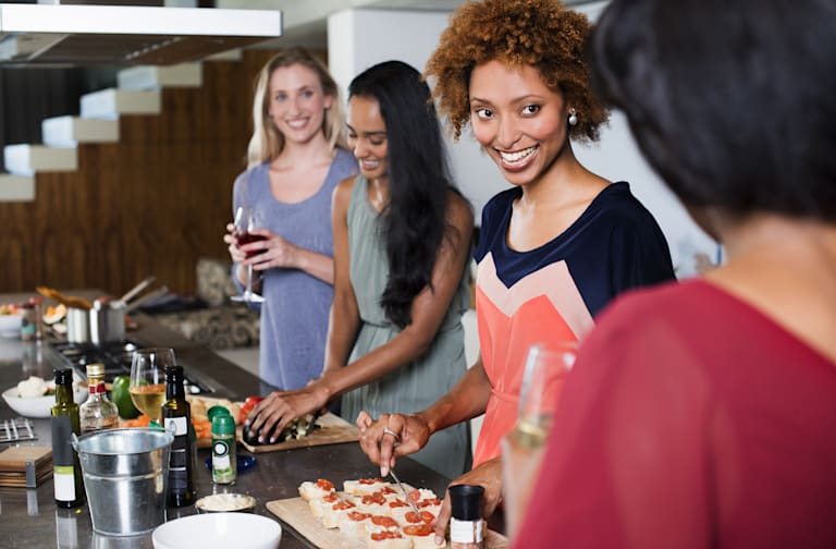 Female friends preparing food together